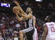 Apr 14, 2014; Houston, TX, USA; San Antonio Spurs guard Tony Parker (9) drives to the basket during the first quarter against the Houston Rockets at Toyota Center. Mandatory Credit: Troy Taormina-USA TODAY Sports