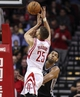 Apr 14, 2014; Houston, TX, USA; Houston Rockets forward Chandler Parsons (25) shoots during the second quarter as San Antonio Spurs forward Tim Duncan (21) defends at Toyota Center. Mandatory Credit: Troy Taormina-USA TODAY Sports