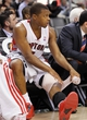 Apr 14, 2014; Toronto, Ontario, CAN; Toronto Raptors guard Kyle Lowry (7) ices his knee at the end of the game against the Milwaukee Bucks at the Air Canada Centre. Toronto defeated Milwaukee 110-100. Mandatory Credit: John E. Sokolowski-USA TODAY Sports