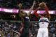 Apr 14, 2014; Washington, DC, USA; Washington Wizards guard John Wall (2) shoots the ball over Miami Heat guard Toney Douglas (0) in the first quarter at Verizon Center. Mandatory Credit: Geoff Burke-USA TODAY Sports