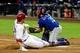 Apr 14, 2014; Phoenix, AZ, USA; Arizona Diamondbacks first baseman Paul Goldschmidt (44) scores as New York Mets catcher Travis d'Arnaud (15) waits for the ball during the first inning at Chase Field. Mandatory Credit: Matt Kartozian-USA TODAY Sports