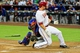 Apr 14, 2014; Phoenix, AZ, USA; Arizona Diamondbacks first baseman Paul Goldschmidt (44) scores as New York Mets catcher Travis d'Arnaud (15) misses the tag during the first inning at Chase Field. Mandatory Credit: Matt Kartozian-USA TODAY Sports