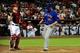 Apr 14, 2014; Phoenix, AZ, USA; New York Mets first baseman Lucas Duda (21) scores as Arizona Diamondbacks catcher Miguel Montero (26) looks on during the first inning at Chase Field. Mandatory Credit: Matt Kartozian-USA TODAY Sports