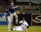 Apr 14, 2014; San Diego, CA, USA; Colorado Rockies shortstop Troy Tulowitzki (2) turns a double play ahead of the slide by San Diego Padres third baseman Chase Headley (7) during the second inning at Petco Park. Mandatory Credit: Christopher Hanewinckel-USA TODAY Sports