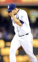 Apr 14, 2014; San Diego, CA, USA; San Diego Padres starting pitcher Eric Stults (53) after allowing a run on a throwing error during the third inning against the Colorado Rockies at Petco Park. Mandatory Credit: Christopher Hanewinckel-USA TODAY Sports