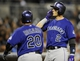 Apr 14, 2014; San Diego, CA, USA; Colorado Rockies catcher Wilin Rosario (20) and shortstop Troy Tulowitzki (2) celebrate after a two-run home run during the fifth inning against the San Diego Padres at Petco Park. Mandatory Credit: Christopher Hanewinckel-USA TODAY Sports