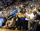 Apr 14, 2014; Oakland, CA, USA; Minnesota Timberwolves forward Corey Brewer (13) falls into the fans trying to keep the ball in play against the Golden State Warriors during the second quarter at Oracle Arena. Mandatory Credit: Kelley L Cox-USA TODAY Sports