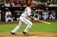 Apr 14, 2014; Phoenix, AZ, USA; Arizona Diamondbacks shortstop Cliff Pennington (4) hits a single during the eighth inning against the New York Mets at Chase Field. Mandatory Credit: Matt Kartozian-USA TODAY Sports