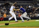 Apr 14, 2014; San Diego, CA, USA; San Diego Padres right fielder Will Venable (25) is tagged out after a rundown with Colorado Rockies third baseman Nolan Arenado (28) during the seventh inning at Petco Park. Mandatory Credit: Christopher Hanewinckel-USA TODAY Sports