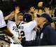Apr 14, 2014; San Diego, CA, USA; San Diego Padres players celebrate after scoring the tying and go-ahead runs on a wild pitch during the eighth inning against the Colorado Rockies at Petco Park. Mandatory Credit: Christopher Hanewinckel-USA TODAY Sports