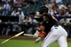 Apr 15, 2014; Phoenix, AZ, USA; Arizona Diamondbacks third baseman Martin Prado breaks a bat during the first inning against the New York Mets at Chase Field. Mandatory Credit: Matt Kartozian-USA TODAY Sports