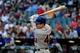 Apr 15, 2014; Phoenix, AZ, USA; New York Mets second baseman Daniel Murphy hits a single during the first inning against the Arizona Diamondbacks at Chase Field. Mandatory Credit: Matt Kartozian-USA TODAY Sports