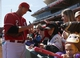 Apr 16, 2014; Cincinnati, OH, USA; Cincinnati Reds third baseman Todd Frazier (21) signs autographs prior to a game with the Pittsburgh Pirates at Great American Ball Park. Mandatory Credit: David Kohl-USA TODAY Sports