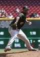Apr 16, 2014; Cincinnati, OH, USA; Pittsburgh Pirates starting pitcher Francisco Liriano throws against the Cincinnati Reds during the first inning at Great American Ball Park. Mandatory Credit: David Kohl-USA TODAY Sports