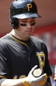 Apr 16, 2014; Cincinnati, OH, USA; Pittsburgh Pirates second baseman Neil Walker checks his bat in the dugout during a game against the Cincinnati Reds at Great American Ball Park. The Reds won 4-0. Mandatory Credit: David Kohl-USA TODAY Sports