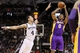 Apr 16, 2014; San Antonio, TX, USA; Los Angeles Lakers forward Nick Young (0) shoots the ball over San Antonio Spurs guard Danny Green (4) during the first half at AT&T Center. Mandatory Credit: Soobum Im-USA TODAY Sports