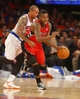 Apr 16, 2014; New York, NY, USA;  Toronto Raptors guard Dwight Buycks (13) is fouled by New York Knicks guard Shannon Brown (26) as he brings the ball up court during the first half at Madison Square Garden. Mandatory Credit: Jim O'Connor-USA TODAY Sports