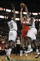 Apr 16, 2014; Boston, MA, USA; Washington Wizards center Marcin Gortat (4) shoots the ball past Boston Celtics forward Jeff Green (8) and Boston Celtics forward Brandon Bass (30) during the first half at TD Garden. Mandatory Credit: Bob DeChiara-USA TODAY Sports