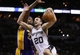Apr 16, 2014; San Antonio, TX, USA; San Antonio Spurs guard Manu Ginobili (20) drives to the basket under pressure from Los Angeles Lakers forward Jordan Hill (behind) during the second half at AT&T Center. The Lakers won 113-100. Mandatory Credit: Soobum Im-USA TODAY Sports