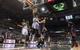 Apr 16, 2014; Milwaukee, WI, USA; Milwaukee Bucks forward Jeff Adrien (12) and forward Chris Wright (15) reach for a rebound during the fourth quarter against the Atlanta Hawks at BMO Harris Bradley Center.  Atlanta won 111-103.  Mandatory Credit: Jeff Hanisch-USA TODAY Sports