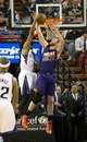 Apr 16, 2014; Sacramento, CA, USA; Phoenix Suns center Miles Plumlee (22) defends the shot by Sacramento Kings forward Rudy Gay (8) during the first quarter at Sleep Train Arena. Mandatory Credit: Kelley L Cox-USA TODAY Sports