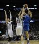 Apr 16, 2014; Memphis, TN, USA; Dallas Mavericks forward Dirk Nowitzki (41) shoots over Memphis Grizzlies center Marc Gasol (33) during the game at FedExForum. Memphis Grizzlies beat the Dallas Mavericks in overtime 106 - 105. Mandatory Credit: Justin Ford-USA TODAY Sports