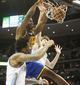 Apr 16, 2014; Denver, CO, USA; Golden State Warriors center Hilton Armstrong (57) dunks the ball during the second half against the Denver Nuggets at Pepsi Center.  The Warriors won 116-112.  Mandatory Credit: Chris Humphreys-USA TODAY Sports