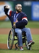 Apr 18, 2014; Arlington, TX, USA; Paralympics hockey gold medalist Taylor Lipsett throws out the ceremonial first pitch prior to the game between the Chicago White Sox and the Texas Rangers at Rangers Ballpark in Arlington. Mandatory Credit: Jim Cowsert-USA TODAY Sports