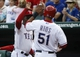 Apr 18, 2014; Arlington, TX, USA; Texas Rangers designated hitter Alex Rios (51) celebrates with manager Ron Washington (38) after scoring against the Chicago White Sox during the first inning at Rangers Ballpark in Arlington. Mandatory Credit: Jim Cowsert-USA TODAY Sports