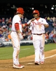 Apr 14, 2014; Philadelphia, PA, USA; Philadelphia Phillies second baseman Chase Utley (26) and right fielder Marlon Byrd (3) celebrate after scoring against the Atlanta Braves at Citizens Bank Park. The Braves defeated the Phillies, 9-6. Mandatory Credit: Eric Hartline-USA TODAY Sports