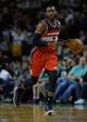 Apr 16, 2014; Boston, MA, USA; Washington Wizards guard John Wall (2) dribbles the ball during the second half against the Boston Celtics at TD Garden. Mandatory Credit: Bob DeChiara-USA TODAY Sports