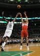 Apr 16, 2014; Boston, MA, USA; Washington Wizards center Marcin Gortat (4) shoots the ball over Boston Celtics forward Jeff Green (8) during the first half at TD Garden. Mandatory Credit: Bob DeChiara-USA TODAY Sports