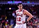 Apr 14, 2014; Chicago, IL, USA; Chicago Bulls guard Kirk Hinrich (12) during the second half at the United Center. Mandatory Credit: Mike DiNovo-USA TODAY Sports