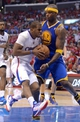 Apr 19, 2014; Los Angeles, CA, USA; Los Angeles Clippers guard Chris Paul (3) drives to the basket as Golden State Warriors center Jermaine O'Neal (7) defends in the second half of game one during the first round of the 2014 NBA Playoffs at Staples Center. Warriors won 109-105. Mandatory Credit: Jayne Kamin-Oncea-USA TODAY Sports