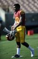 Apr 19, 2014; Los Angeles, CA, USA; Southern California quarterback Jalen Greene (10) walks off the field during the Southern California Spring Game at Los Angeles Memorial Coliseum. Mandatory Credit: Kelvin Kuo-USA TODAY Sports