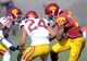 Apr 19, 2014; Los Angeles, CA, USA; Southern California quarterback Jalen Greene (10) runs the ball defended by Southern California outside linebacker Quinton Powell (18) and safety Elijah Steen (24) during the Southern California Spring Game at Los Angeles Memorial Coliseum. Mandatory Credit: Kelvin Kuo-USA TODAY Sports