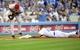 April 19, 2014; Los Angeles, CA, USA; Los Angeles Dodgers center fielder Matt Kemp (27) steals third in the fifth inning ahead of Arizona Diamondbacks right fielder Gerardo Parra (8) at Dodger Stadium. Mandatory Credit: Gary Vasquez-USA TODAY Sports