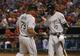 Apr 19, 2014; Arlington, TX, USA; Chicago White Sox first baseman Jose Abreu (79) celebrates with shortstop Alexei Ramirez (10) after scoring during the eighth inning against the Texas Rangers at Globe Life Park in Arlington. Texas won 6-3. Mandatory Credit: Kevin Jairaj-USA TODAY Sports