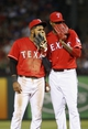 Apr 19, 2014; Arlington, TX, USA; Texas Rangers shortstop Elvis Andrus (left) and relief pitcher Alexi Ogando (right) speak during the game against the Chicago White Sox at Globe Life Park in Arlington. Texas won 6-3. Mandatory Credit: Kevin Jairaj-USA TODAY Sports