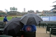 Apr 21, 2014; Chicago, IL, USA; Fans sit under umbrellas as rain falls before the game between the Chicago Cubs and the Arizona Diamondbacks at Wrigley Field. Mandatory Credit: Jerry Lai-USA TODAY Sports