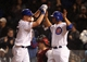 Apr 21, 2014; Chicago, IL, USA; Chicago Cubs starting pitcher Travis Wood (left) celebrates with catcher Welington Castillo (right) after hitting a three-run home run against the Arizona Diamondbacks during the second inning at Wrigley Field. Mandatory Credit: Jerry Lai-USA TODAY Sports