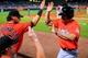 Apr 21, 2014; Atlanta, GA, USA; Miami Marlins left fielder Reed Johnson (5) celebrates scoring in the ninth inning against the Atlanta Braves at Turner Field. Mandatory Credit: Daniel Shirey-USA TODAY Sports