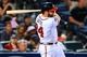 Apr 21, 2014; Atlanta, GA, USA; Atlanta Braves catcher Evan Gattis (24) hits a walk off two run home run in the tenth inning against the Miami Marlins at Turner Field. Mandatory Credit: Daniel Shirey-USA TODAY Sports