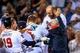 Apr 21, 2014; Atlanta, GA, USA; Atlanta Braves catcher Evan Gattis (24) celebrates a walk off two run home run in the tenth inning against the Miami Marlins at Turner Field. Mandatory Credit: Daniel Shirey-USA TODAY Sports