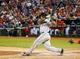 Apr 19, 2014; Arlington, TX, USA; Chicago White Sox right fielder Dayan Viciedo (24) bats during the game against the Texas Rangers at Globe Life Park in Arlington. Texas won 6-3. Mandatory Credit: Kevin Jairaj-USA TODAY Sports