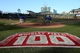 Apr 22, 2014; Chicago, IL, USA; A general view of a 100-year anniversary logo painted on the field as grounds crew members prepare the field before the game between the Chicago Cubs and Arizona Diamondbacks at Wrigley Field. Mandatory Credit: Jerry Lai-USA TODAY Sports