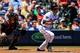 Apr 23, 2014; Atlanta, GA, USA; Atlanta Braves catcher Ryan Doumit (4) hits an RBI single in the fourth inning against the Miami Marlins at Turner Field. Mandatory Credit: Daniel Shirey-USA TODAY Sports