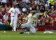 Apr 25, 2014; St. Louis, MO, USA; Pittsburgh Pirates third baseman Pedro Alvarez (24) boots a ball bunted by St. Louis Cardinals third baseman Matt Carpenter (not pictured) during the first inning at Busch Stadium. Mandatory Credit: Jeff Curry-USA TODAY Sports