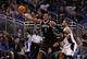 Apr 9, 2014; Orlando, FL, USA; Brooklyn Nets guard Joe Johnson (7) grabs the ball against the Orlando Magic  during the second half at Amway Center. Orlando Magic defeated the Brooklyn Nets 115-111. Mandatory Credit: Kim Klement-USA TODAY Sports