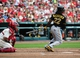 Apr 26, 2014; St. Louis, MO, USA; Pittsburgh Pirates center fielder Andrew McCutchen (22) hits a single run off of St. Louis Cardinals starting pitcher Tyler Lyons (not pictured) during the fourth inning at Busch Stadium. Mandatory Credit: Jeff Curry-USA TODAY Sports